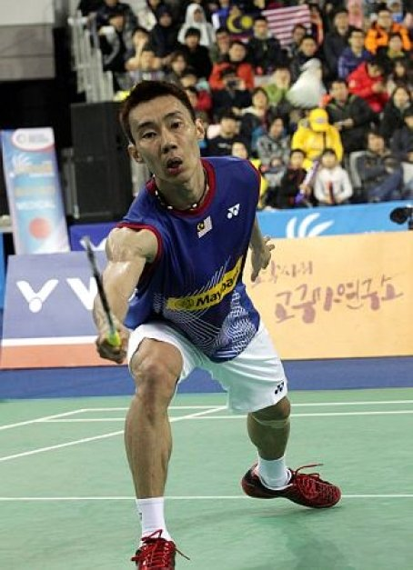 Malaysia's Lee Chong Wei returns a shot against China's Chen Long during their men's singles final match at the Korea Open Badminton tournament in Seoul, South Korea, Sunday, Jan. 12, 2014. Chen won the match 21-14, 21-15.