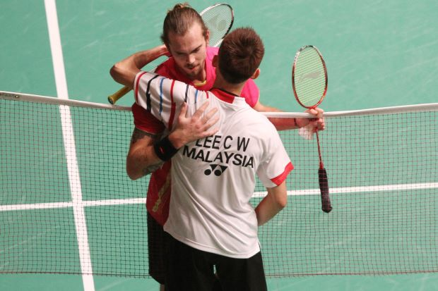 Lee Chong Wei consoles his semi-final opponent from Denmark Jan O Jorgensen after latter retired injured from their match at Putra Stadium on Saturday.