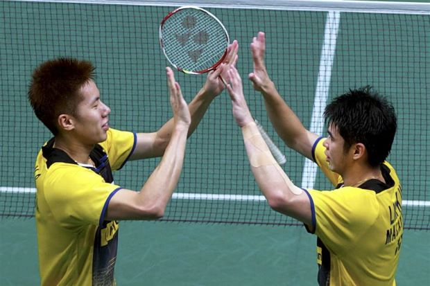 Lim Khim Wah (right) celebrates with Goh V Shem after beating Chinese pair Hong Wei-Chai Biao during the Malaysian Open last Sunday.