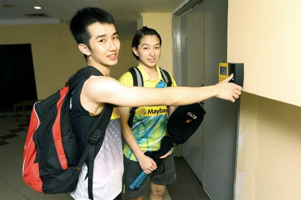 National shuttlers Chong Wei Feng (left) and Ho Yen Mei using the thumb print access system before entering Stadium Juara for training.