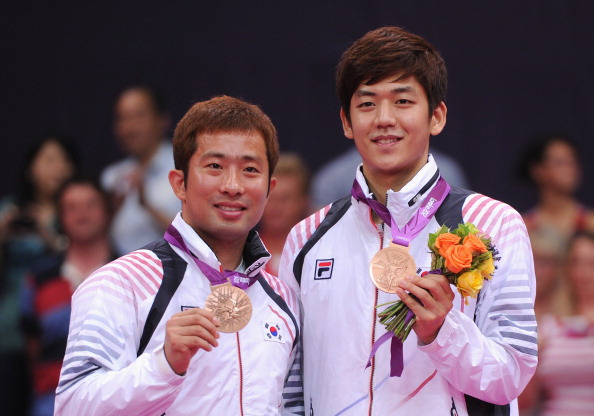 Lee Yong-Dae (right) and Jae Sung Chung of Korea stand with their Bronze medals following the Men's Doubles Badminton Gold Medal match at the London 2012 Olympics.