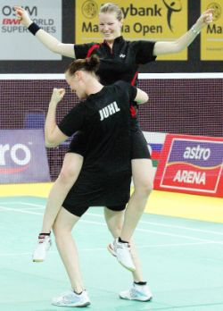 Danish delight: Christina Pedersen (top) and Kamilla Rytter Juhl celebrate after beating South Korea's Ha Jungeun- Kim Min-jung 21-19, 21-18 to win the women's doubles final yesterday.