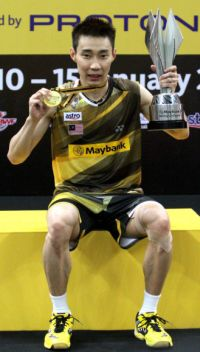 Home comfort: Lee Chong Wei with the trophy and medal he received for winning the Malaysia Open yesterday. Chong Wei defeated Japan's Kenichi Tago 21-6, 21-13 in the final.