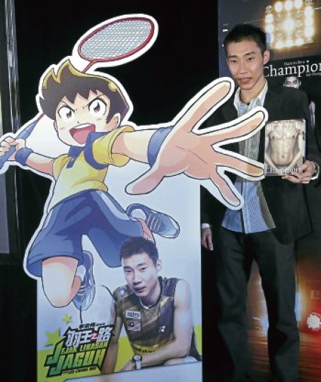 Lee Chong Wei holding a copy of his autobiography 'Dare to be a Champion' beside a cutout of the comic 'Jejak Libasan Jaguh' yesterday.  Read more: Chong Wei ready for China backlash - Badminton - New Straits Times http://www.nst.com.my/sports/badminton/chong-wei-ready-for-china-backlash-1.34370#ixzz1jsTeaZ7V