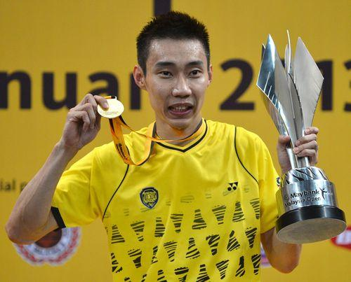 Chong Wei celebrates with his trophy and his gold medal during the awards ceremony after defeating Indonesia's Sony Dwi Kuncoro in the men's single final at the Malaysia Open Badminton Superseries in Kuala Lumpur on Jan 20