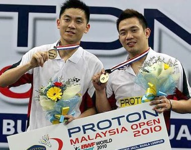 Malaysia's Koo Kien Keat and Tan Boon Heong with the winning mock cheque after beating China's Guo Zhengdong and Xu Chen in the Malaysian Open Badminton Final at Putra stadium in Bukit Jalil Sunday. The Malaysian pair won 21-15 17-21 21-16.