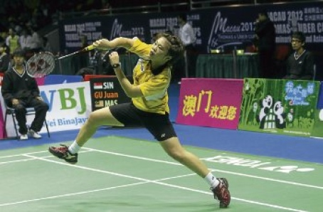 Tee Jing Yi returns a shot to Singapore's Gu Juan yesterday. Jing Yi won 21-13, 10-21, 21-15.