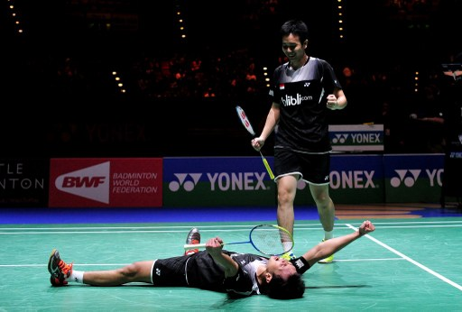 Sweet victory: Mohammad Ahsan (left) and Hendra Setiawan of Indonesia react after beating Hiroyuki Endo and Kenichi Hayakaway of Japan in their All England Open Badminton Championships men's doubles final match in Birmingham, central England, on Sunday. The world's No. 1 pair defeated the Japanese pair 21-19, 21-19.