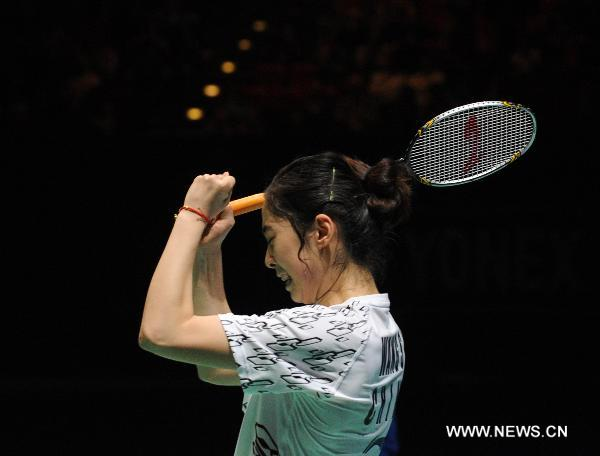 China's Wang Shixian celebrates after winning the women's singles final match against Japan's Eriko Hirose in 2011's All England Open Badminton Championship at the National Indoor Arena in Birmingham, Britain, March 13, 2011. Wang won 2-0 to claim the title.
