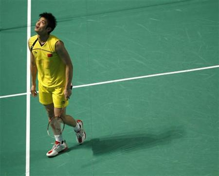 China's Lin Dan reacts after losing a point to South Korea's Choi Ho-jin during the men's badminton singles final match at the East Asian Games in Hong Kong December 13, 2009.