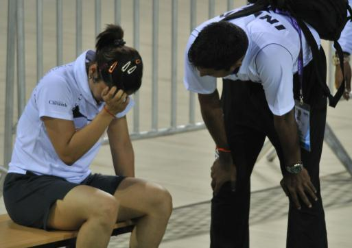 TOO HARD TO DIGEST: Saina nehwal breaks down after losing in the semifinals of the badminton Asia Championship in New Delhi. At right is coach Gopi Chand.
