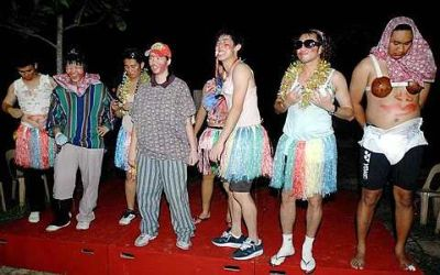 Dressed to kill: Thomas and Uber Cup players participate in a fancy dress contest during their motivation camp in Port Dickson Sunday.