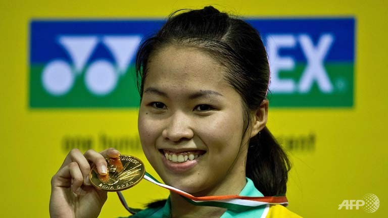 Thailand's Ratchanok Intanon displays her winning medal after beating Juliane Schenk of Germany in the women's singles final of the India Open on April 28, 2013