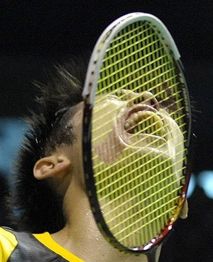 China's Lin Dan celebrates after defeating South Korea's Park Sung Hwan during the men's singles final match