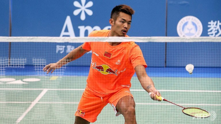 Lin Dan hits a return against Tuan Duc Do during their men's singles first round match at the Badminton Asia Championships in Taipei.
