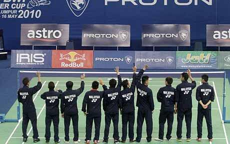 Peace wave? Malaysia's badminton squad wave to fans before the tournament proper gets under way
