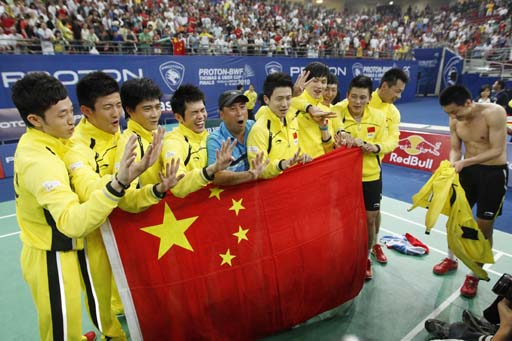 Flagging: Members of the Chinese team pose for a photo with their national flag after they defeated Indonesia in the final of the Thomas Cup badminton championships in Kuala Lumpur on Sunday.