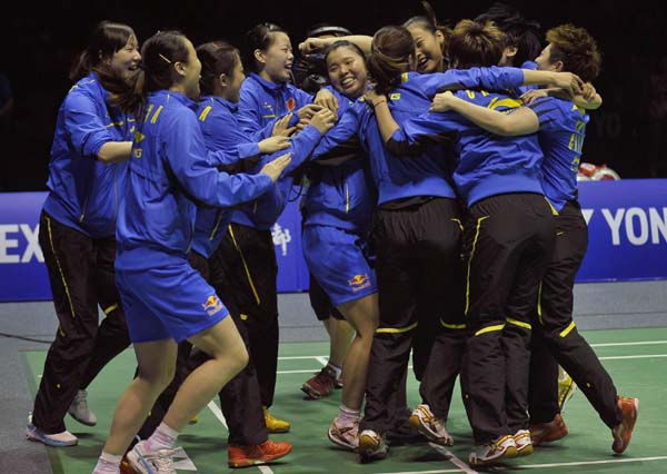 The China team celebrates after defeating South Korea in the final round of the Uber Cup badminton tournament in Wuhan, Hubei province, May 26, 2012.