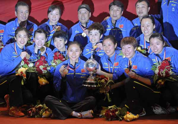 The China team poses for pictures with the Uber Cup trophy and their gold medals after defeating South Korea in the final round of Uber Cup badminton tournament in Wuhan May 26, 2012.