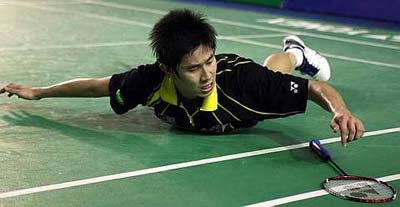 Malaysia's Tan Chun Seang takes a fall during the men singles quater-finals match against China's Chen Long at the Malaysia Open GP Gold in Johor Bharu on Friday.
