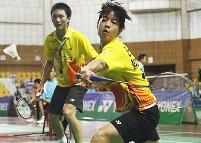 Beaten pair: Malaysia's Shevon Lai Jemie returning a shot while Goh Jian Hao looks on during their match against Vietnam's Bui Quang Tuan-Vu Thi Trang at the Asian Junior Championships Sunday.