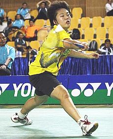Determined display: Malaysia's Tee Jing Yi in action against China's Chen Xiaojia during the Asian junior championships mixed team final Wednesday.