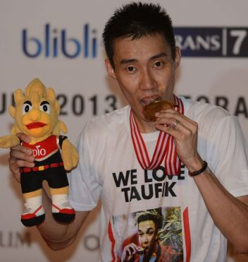 Lee Chong Wei bites his gold medal after winning the Indonesia Open title in Jakarta last month. Lee, 30, who became a father in April to son Kingston, knows that this could be his last chance to beat Lin Dan on the big stage, after losing the last two Olympic finals to the fiercely competitive Chinese player, as well as the 2011 world title match.