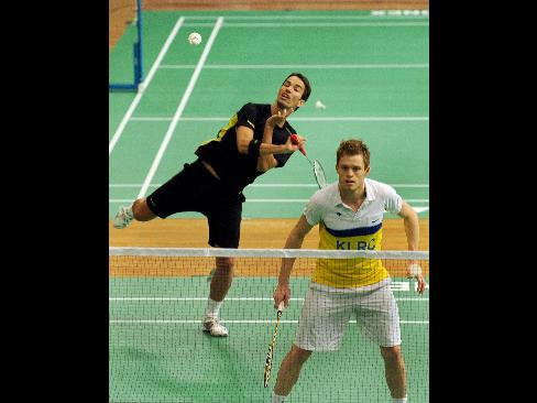 England badminton players Nathan Robertson, left, and Andrew Smith practice with teammates at the venue of the World Badminton Championships in Hyderabad, India on Aug. 8, 2009.