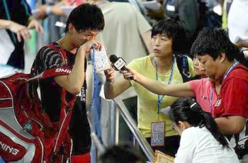 Early exit: A dejected Bao Chunlai talking to the Chinese press after losing his first-round match to Holland's Dicky Palyama Monday.