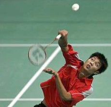 Safely through: Thailand&rsquo;s Boonsak Ponsana using his Kumpoo racquet to return a shot to Lithuania&rsquo;s Kestutis Navickas yesterday. Boonsak won 21-14, 14-21, 21-17