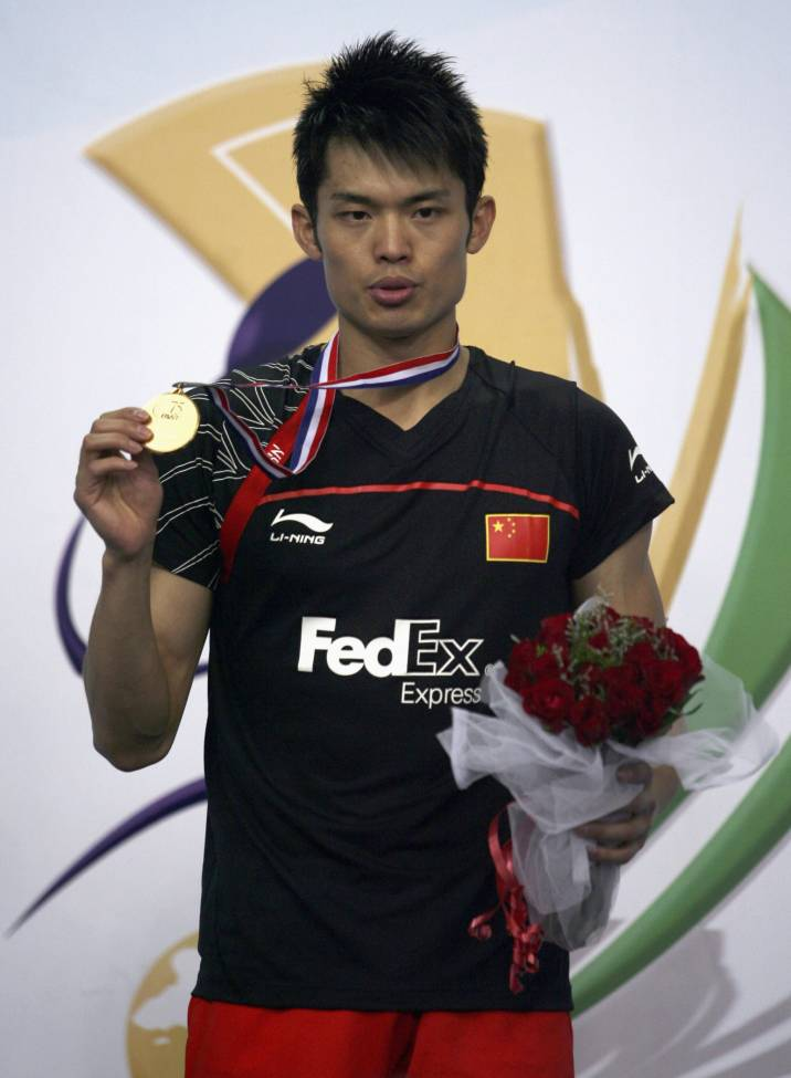 China's Lin Dan poses with his gold medal during an award ceremony in the southern Indian city of Hyderabad August 16, 2009. Lin won the gold against his compatriot Chen Jin in their final men's singles match in the World Badminton Championships.