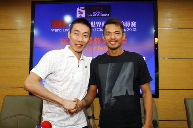 Face-off: World No.1 Lee Chong Wei (left) and China's four-time world champion Lin Dan during a press conference at the Tianhe Gymnasium.