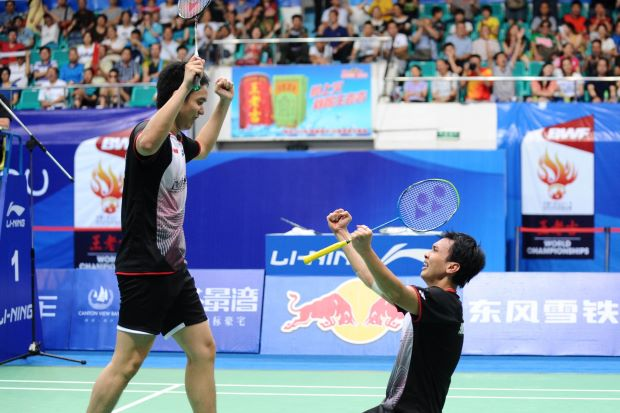 Mohd Ahsan and Hendra Setiawan (left) celebrate after winning the men's doubles final at World Badminton Championships in Guangzhou.