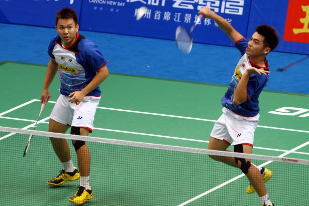Malaysia's men's doubles shuttlers Tan Wee Kiong and Hoon Thien How (left) lost to China's Cai Yun-Fu Haifeng in the third round of the World Championships in Guangzhou. Coach Tan Kim Her believes the duo could have pulled off a big upset had Thien How been trimmer and fitter.