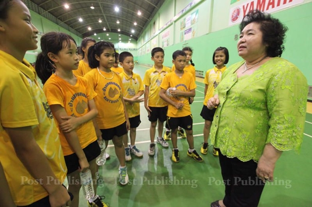 School owner Kamala Thongkorn meets with some of the aspiring badminton players.