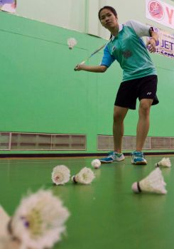 In this Friday, Aug. 16,2013 photo, Thailand's Ratchanok Inthanon serves during a training session in Bangkok, Thailand. The Thai teenager last week became the youngest-ever world badminton champion, and the first Thai player to win a world title.