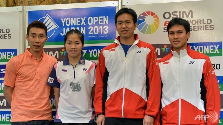 L-R: Badminton players Lee Chong Wei of Malaysia, Ratchanok Intanon of Thailand, and Indonesians Hendra Setiawan and Mohammad Ahsan pose for photos at a press conference in Tokyo, Japan.