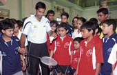 Pullela Gopichand instructs youngsters at a badminton clinic in a city school, on Saturday.