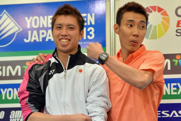 Lee Chong Wei and Kenichi Tago (left) at a press conference before the Japan Open started. The duo will meet on the court in the men's singles final on Sunday.