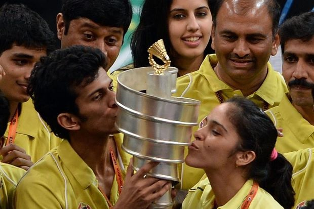 Hyderabad Hotshots player Ajay Jayaram (second from left) and Saina Nehwal (right) kissing the trophy as they celebrate after their team won the Indian Badminton League in Mumbai on Saturday.