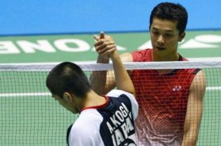 Taufik Hidayat of Indonesia (R) is congratulated by Akira Koga of Japan during their men's singles second round match at the Japan Open badminton championships in Tokyo on September 20, 2012. Hidayat won 21-11, 21-10