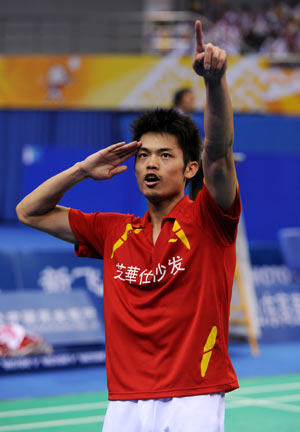 Lin Dan of the People's Liberation Army (PLA) team celebrates after winning the men's singles final of badminton against Bao Chunlai of Hunan province at the 11th Chinese National Games in Jinan, east China's Shandong Province, Oct. 18, 2009. Lin won the match 2-0 and claimed the title of the event.