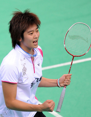 Wang Lin of Zhejiang province jubilates after the women's singles final of badminton against Wang Shixian of Jiangsu province at the 11th Chinese National Games in Jinan, east China's Shandong Province, Oct. 17, 2009. Wang won the match 2-1 and claimed the title of the event.