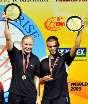 Poland's Robert Mateusiak/Nadiezda Kostiuczyk(R) display their winner trophies during the awarding ceremony after mixed doubles final match against Indonisia's Nova Widianto/Liliyana Natsir at Hong Kong open super series 2009 in Hong Kong, south China, Nov. 15, 2009. Robert Mateusiak/Nadiezda Kostiuczyk won 2-0, and claimed the title of the event.