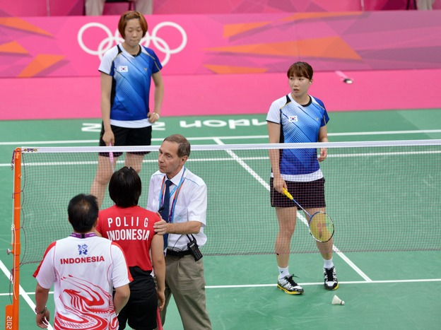Referee Torsten Berg tried to get players from Indonesia (near court) and South Korea to try their hardest during this match at the London Olympics. The format gave some teams an incentive to lose — in order to get easier opponents in upcoming matches. That format's being changed