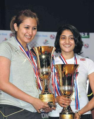 G. Jwala and Ashwini Ponnappa pose with their spoils after triumphing in straight games.