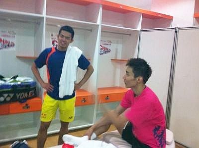 Healthy rivalry: Lin Dan sharing a light moment with Lee Chong Wei in the dressing room after their China Open semi-final match last week.