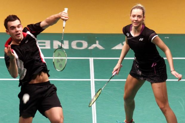Chris (left) and Gabrielle Adcock in action against Germany's Michael Fuchs-Birgit Michels during the second round of the Maybank Malaysian Open at the Putra Stadium in Bukit Jalil on Jan 16, 2014. The Adcocks won 23-21, 16-21, 21-6.