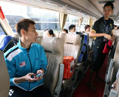 Friendly banter: Lee Chong Wei (left) having a chat with Mohd Hafiz Hashim in the team bus after their training session at the Wuhan Sports Centre Sunday.