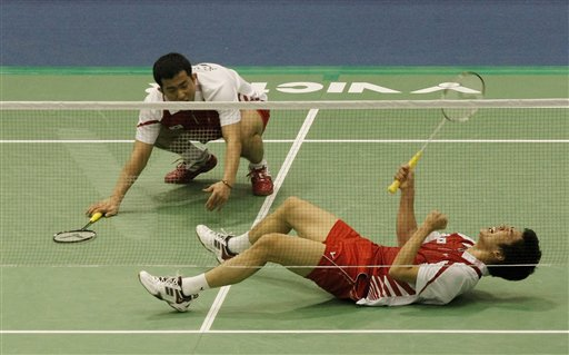 South Korean Lee Yong- dae, bottom, reacts after scoring a point as his teammate Jung Dung-jae looks on during men's doubles final match against Chinese Cai Yun and Fu Haifeng during the Korea Open Badminton Super Series in Seoul, South Korea, Sunday, Jan. 17, 2010. South Korea won the match 21-11, 14-21 and 21-18.
